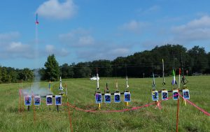 A full rack of well done rockets. One takes off from pad A2 on it's maiden voyage.